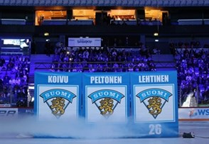 HELSINKI, FINLAND - DECEMBER 26: Former Finnish national team members Saku Koivu #11, Ville Peltonen #16 and Jere Lehtinen #26 have their numbers retired during a on-ice ceremony at the 2016 IIHF World Junior Championship. (Photo by Andre Ringuette/HHOF-IIHF Images)