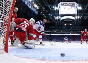 HELSINKI, FINLAND - DECEMBER 29: Russia's Yevgeni Svechnikov #7 watches this puck find the back of the net past Vladislav Verbitski #25 of Belarus during preliminary round action at the 2016 IIHF World Junior Championship. (Photo by Andre Ringuette/HHOF-IIHF Images)