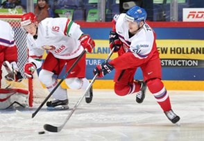 HELSINKI, FINLAND - DECEMBER 30: Jakub Zboril #20 of the Czech Republic skates with the puck while Grigori Veremyov #15 of Belarus chases him down during preliminary round action at the 2016 IIHF World Junior Championship. (Photo by Andre Ringuette/HHOF-IIHF Images)