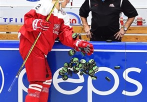 HELSINKI, FINLAND - DECEMBER 30: Denmark's Anders Krogsgaard #2 knocks puck to the ice for warmup during preliminary round action at the 2016 IIHF World Junior Championship. (Photo by Matt Zambonin/HHOF-IIHF Images)