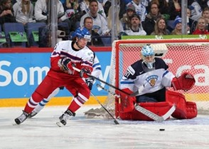 HELSINKI, FINLAND - DECEMBER 31: Jan Scotka #23 of the Czech Republic with a scoring chance against Finland's Veini Vehvilainen #30 during preliminary round action at the 2016 IIHF World Junior Championship. (Photo by Andre Ringuette/HHOF-IIHF Images)