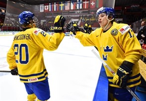 HELSINKI, FINLAND - JANUARY 2: Sweden's Joel Eriksson Ek #20 high fives Sweden's Dmytro Timashov #17 after scoring a first period goal during quarterfinal round action at the 2016 IIHF World Junior Championship. (Photo by Matt Zambonin/HHOF-IIHF Images)