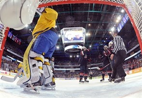 HELSINKI, FINLAND - JANUARY 5: USA's Sonny Milano #28, Louis Belpedio #8 and Christian Dvorak #11 celebrates after a first period goal on Sweden's Felix Sandstrom #1 during bronze medal game action at the 2016 IIHF World Junior Championship. (Photo by Matt Zambonin/HHOF-IIHF Images)